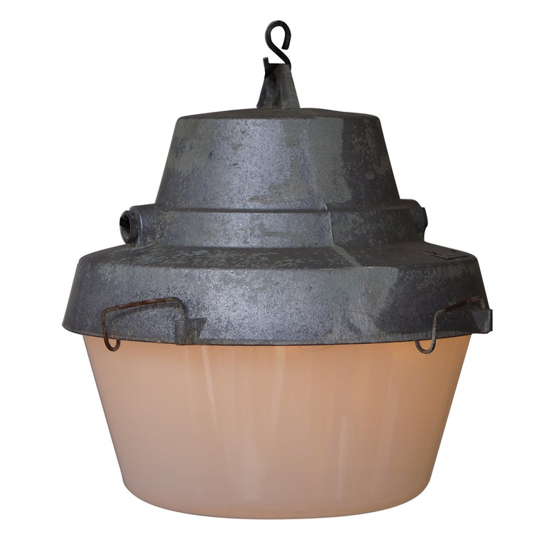 One of Five Industrial Pendant Lights For Sale