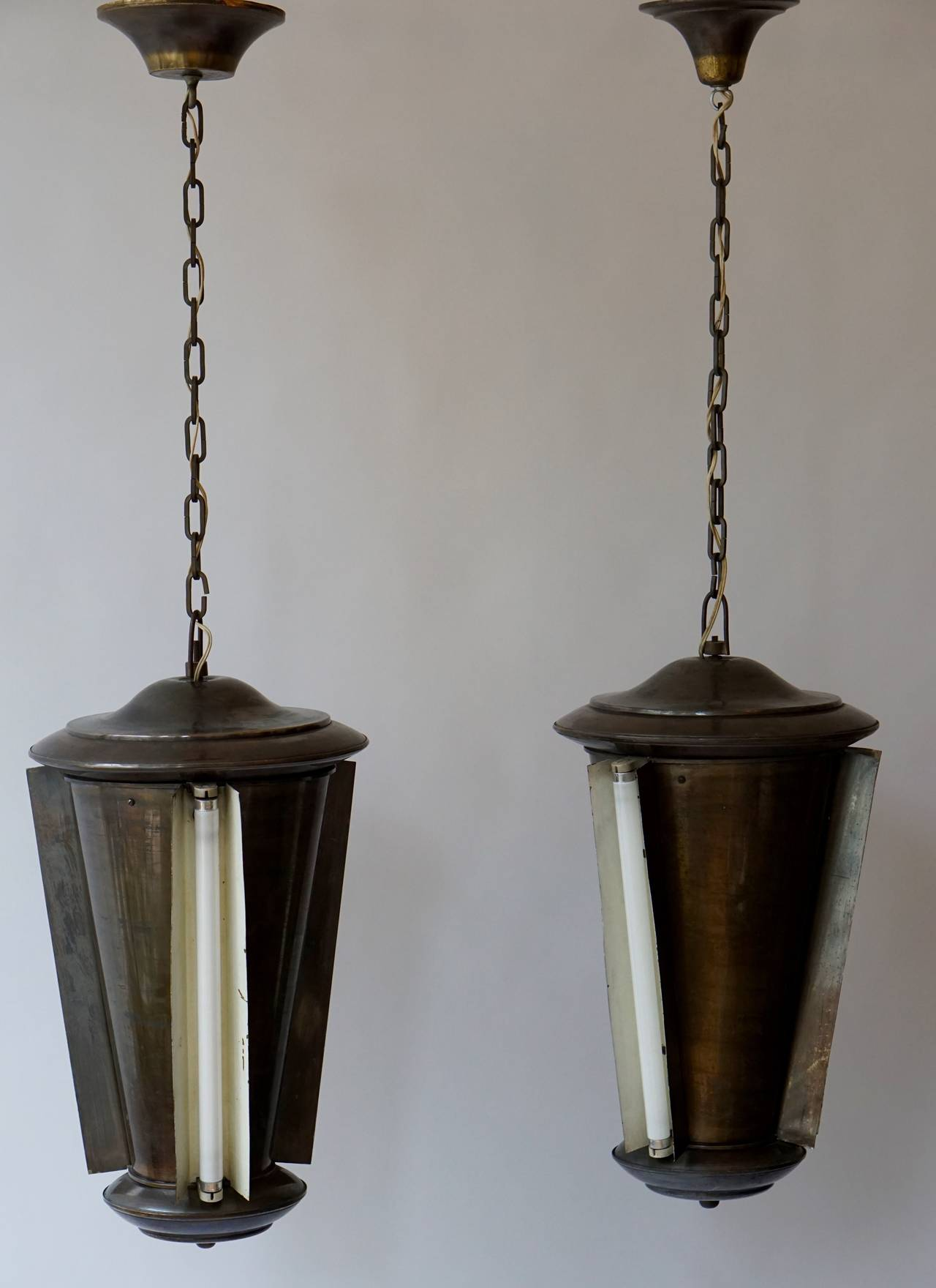 Two conical Industrial lights.
