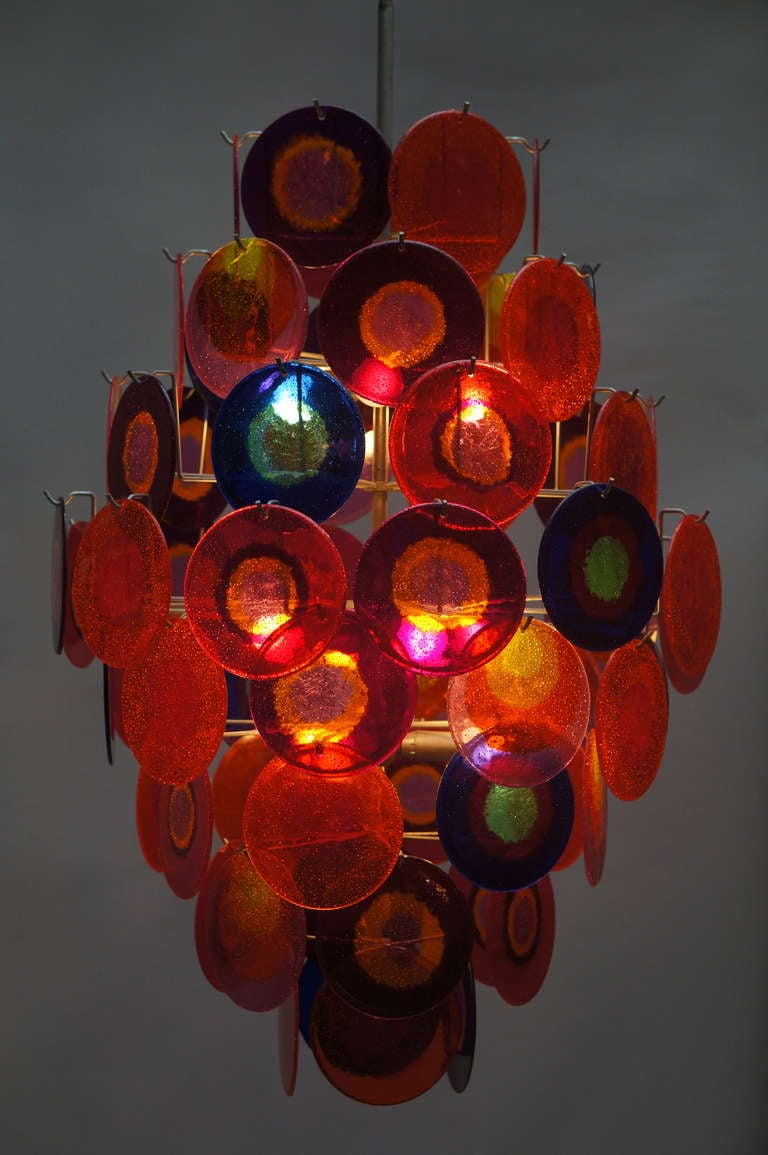 Large chandelier with 64 colorful plastic discs.