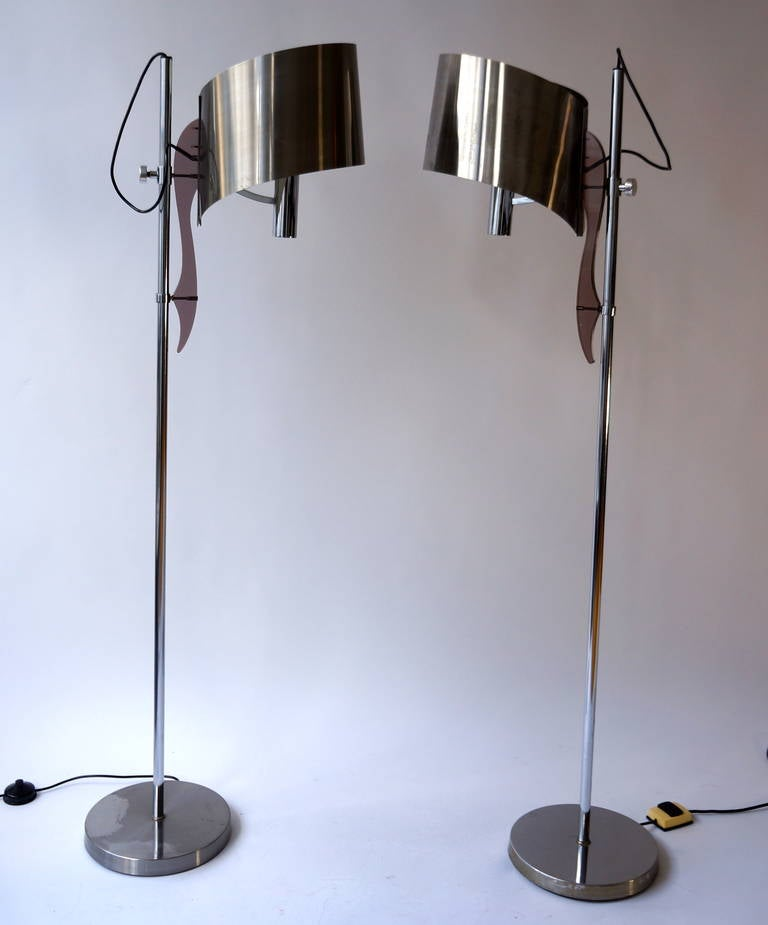 Very nice floor lamps by Maison Charles with adjustable shade.This typical design by Maison Charles has a very nice brown perspex detail and the shade is adjustable in height.The brushed aluminum shade has an organic shape and some minor wear due to
