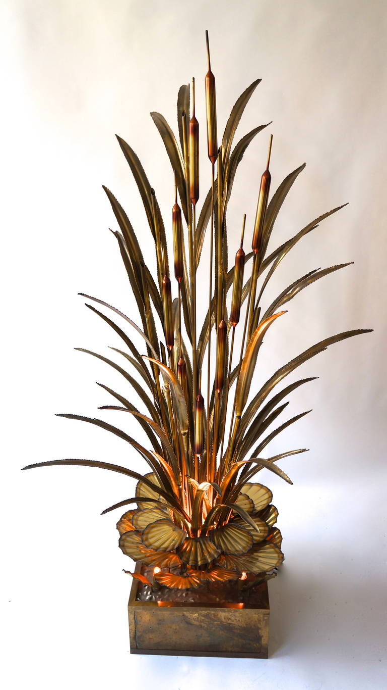 One large brass floor lamp in the form of Bull Rushes with light fittings, one to the centre and four to from beneath.