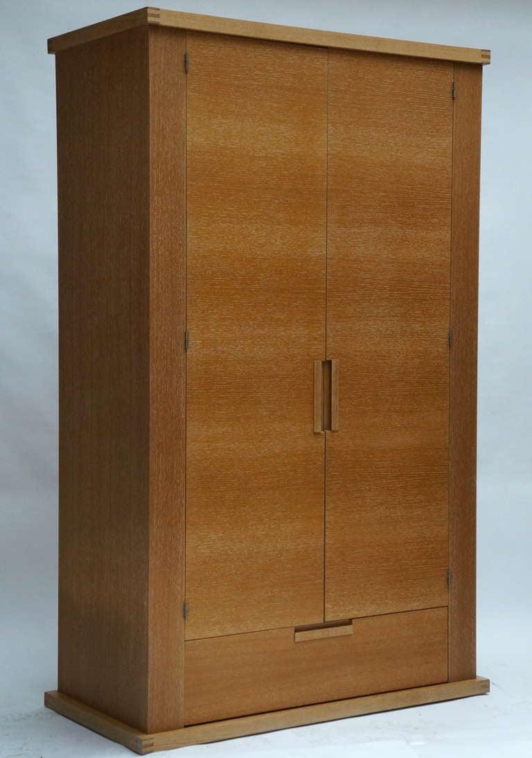 Limed oak two door armoire. Height 210 cm. Width 127 cm. Depth 64 cm.