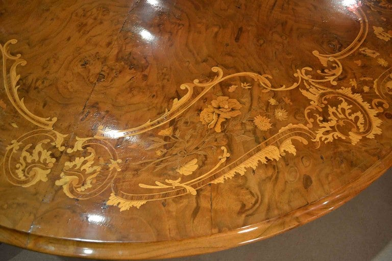 A stunning and rare English antique Victorian marquetry loo table.   Made from burr walnut with hand carved solid walnut base, circa 1870 in date. It is rare to find circular loo tables that are 156 cm in diameter as most of them are around 130