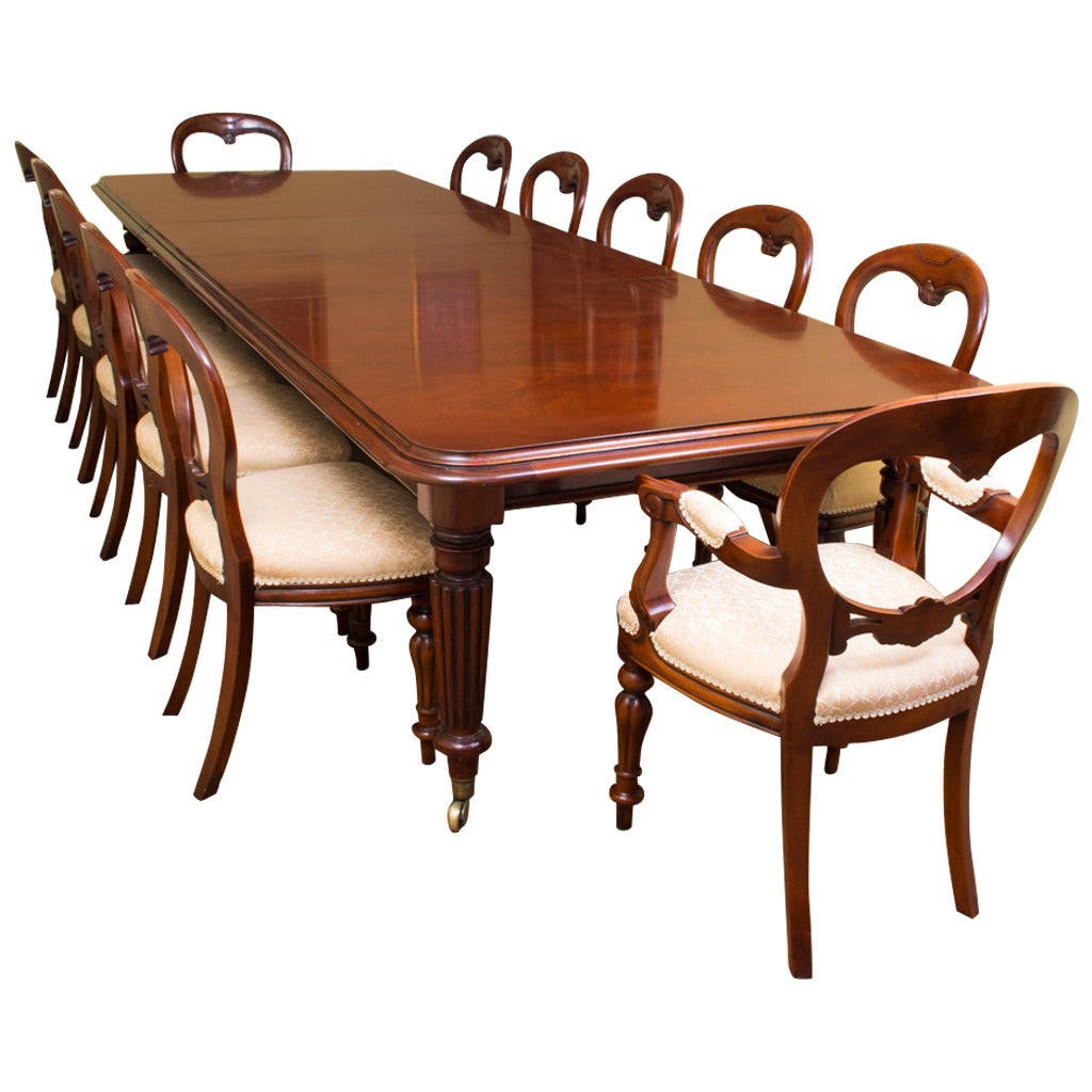 Vintage mahogany dining table and 12 chairs at 1stdibs for Dining room tables for 12 or more