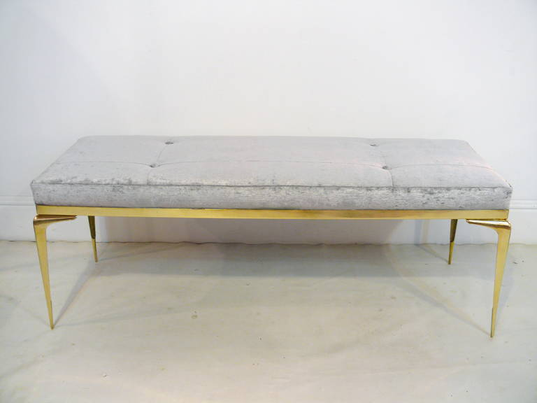 "Updated custom stiletto bench designed by Irwin Feld Design for CF Modern.  Featuring four hand cast, hand polished solid brass ""stiletto"" legs and a solid brass border with an upholstered top (shown here with Robert Allen fabric). Available COM and"