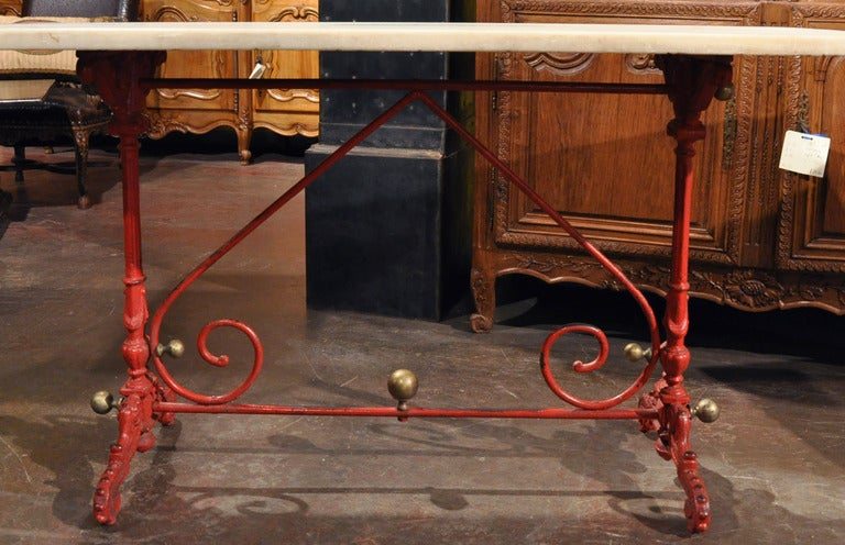 Incorporate extra surface space into your kitchen area with this antique iron butcher table (or pastry table) from France, circa 1820. The traditional table sits on two pedestal legs supported with scroll stretcher, and is embellished with five
