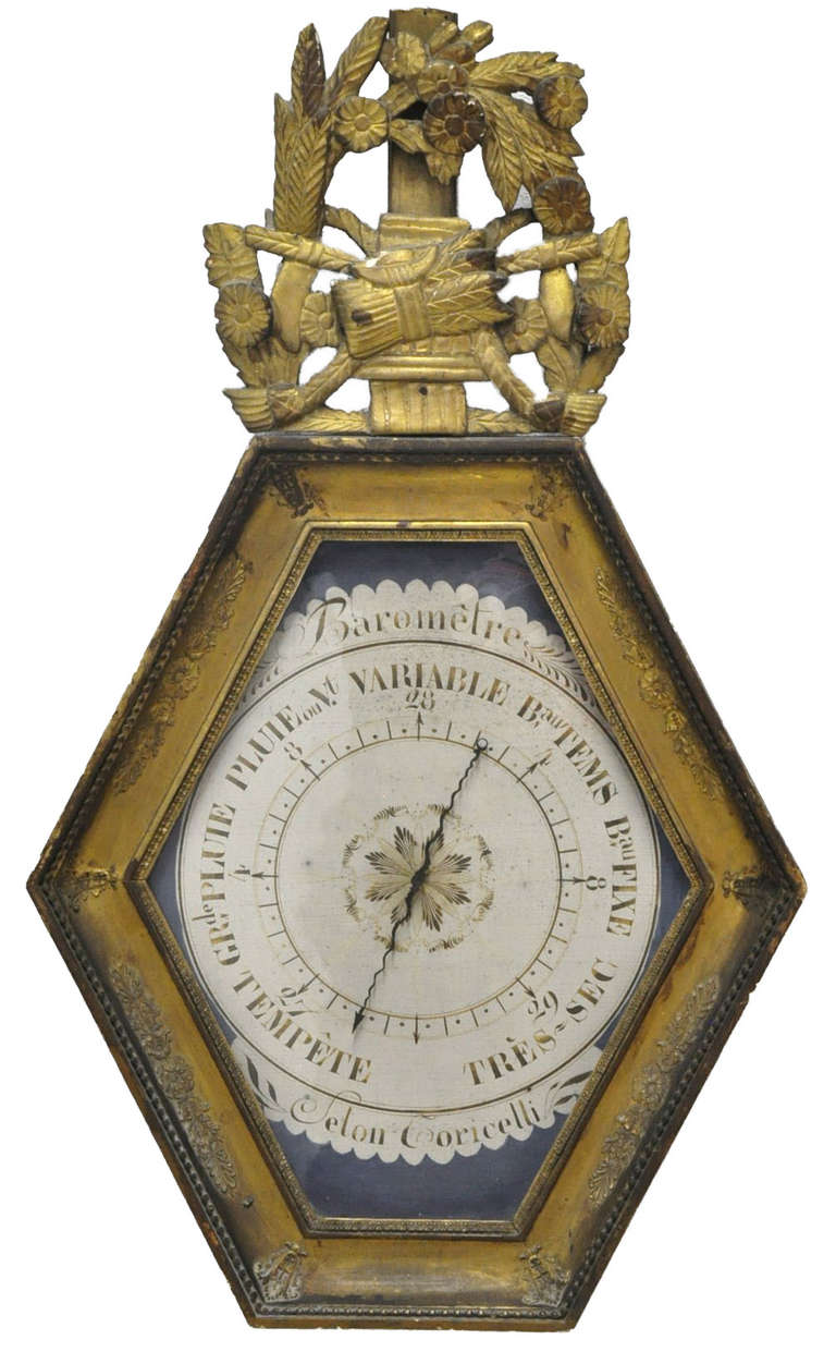 This elegant, antique Louis XVI barometer was crafted in Paris, France, circa 1760. The hexagonal-shaped wall piece features its original hand painted blue parchment paper barometer with French inscriptions written in Indian ink. The mechanism is