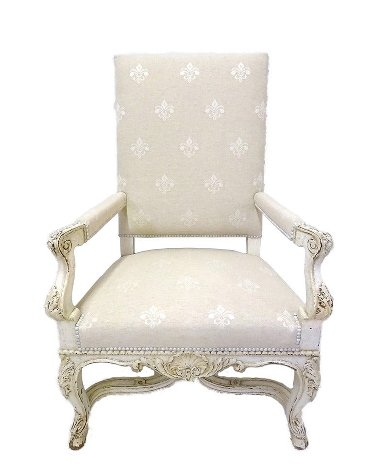These elegant antique Louis XV armchairs were crafted in France, circa 1870. Each large chair sits on cabriole legs finished with hoof feet under a scalloped apron decorated with a central hand carved shell motif, it features a square back, a deep