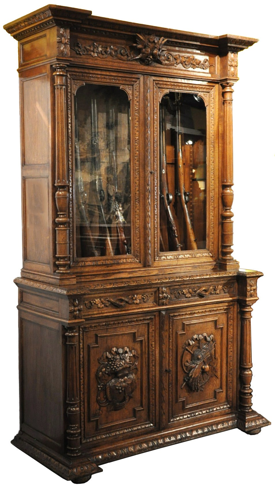 19th C. Carved Gun Cabinet from Normandy 2 - 19th C. Carved Gun Cabinet From Normandy At 1stdibs