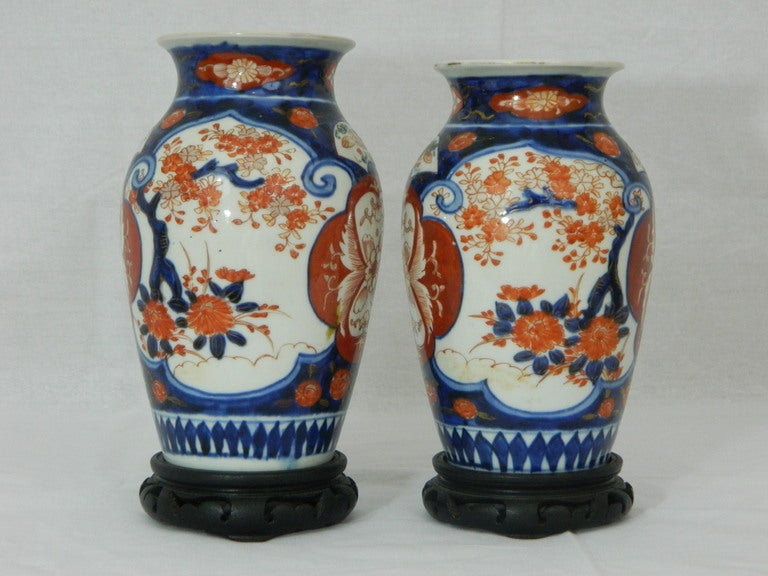 Japanese Pair of Imari Vases Depicting Floral Decorations on Stands, 19th Century For Sale