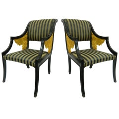 Pair of French Empire Style Ebonized Armchairs with Carved Gilded Wings