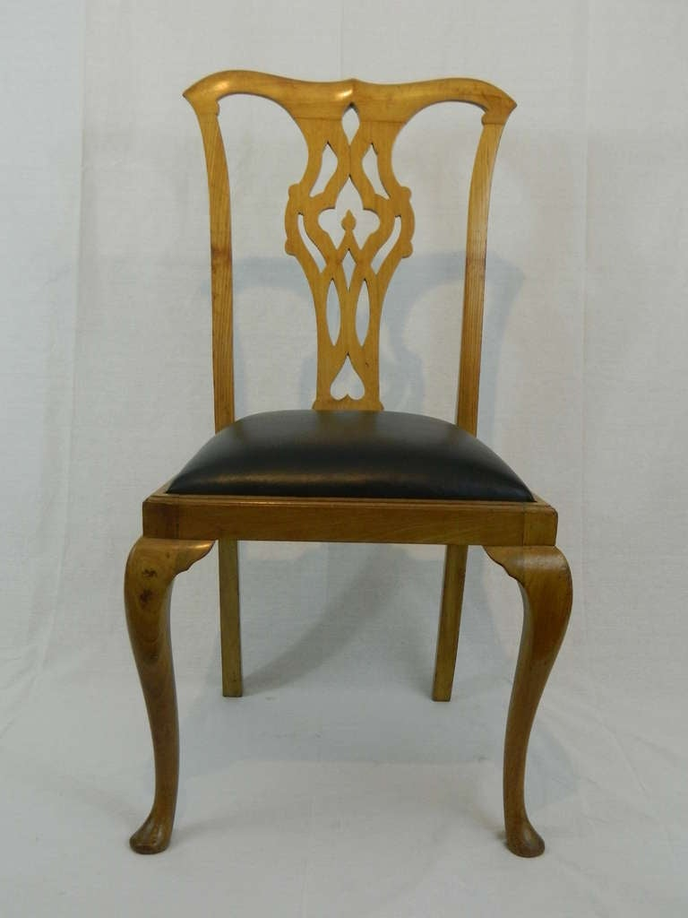 19th century set of four Chippendale style side chairs with covered seats in black leather.