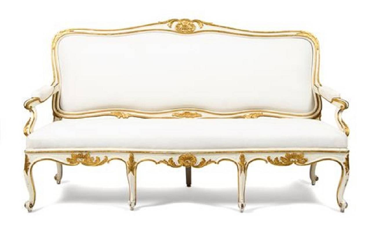 Gustavian Painted and Parcel Gilt Canape or Sofa; having a shell carved crest rail above a padded back and a stuffover seat, raised on cabriole legs, 19th Century