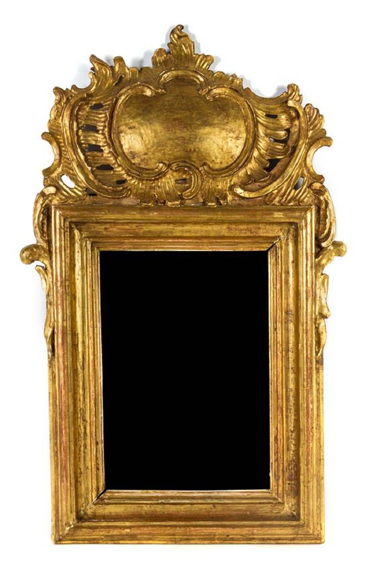 Louis XV style giltwood mirror having a rectangular mirror plate within a conforming molded frame surmounted by a cartouche and a foliate scroll crest, 20th Century