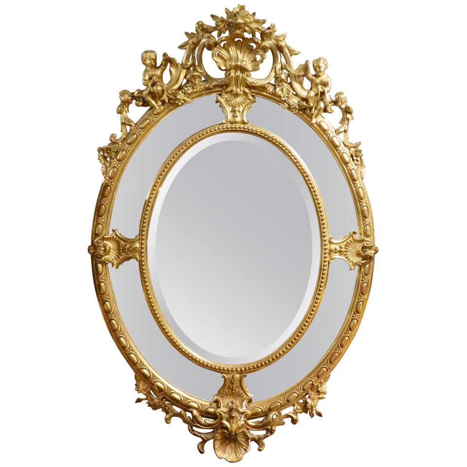 English 24-Karat Water Gilt Oval Mirror Adorned with Cherubs and Shells