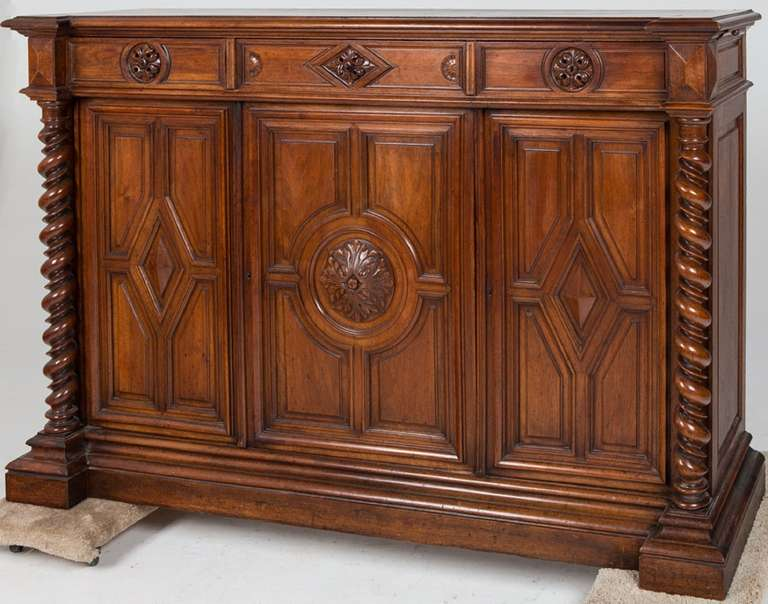 19th Century French Renaissance Style Walnut Sideboard or Side Cabinet,  the rectangular top above three drawers, the sides with slides, over cabinet doors flanked by barley twist supports, on a plinth