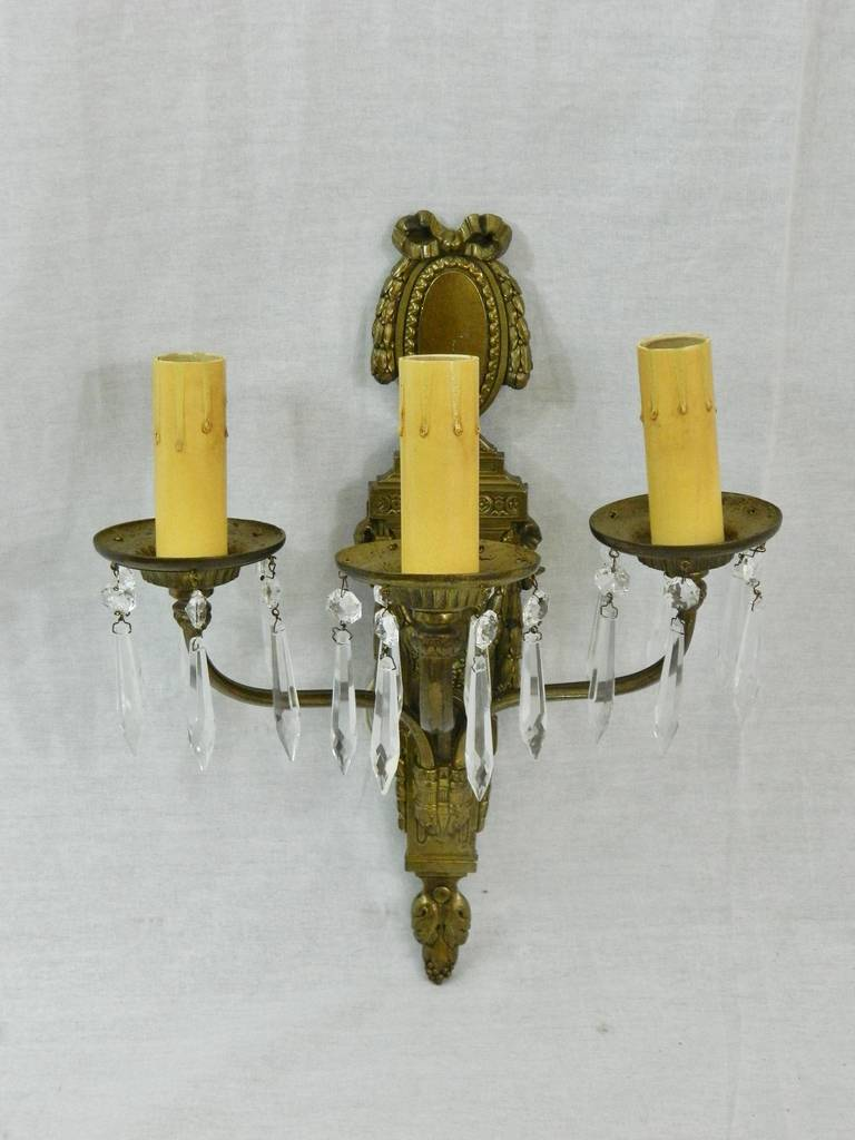 Circa 1920s Pair of Caldwell Bronze Dore and Crystal Three Arm Sconces.