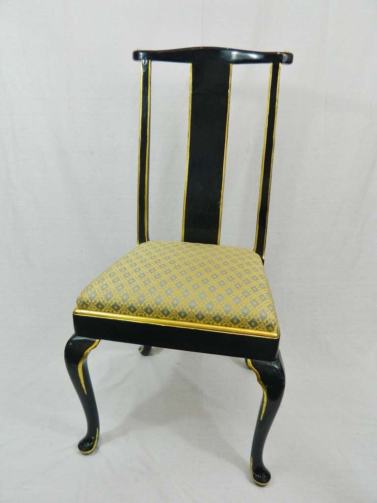 Early 20th century set of twelve Italian dining chairs with cabriole legs. Navy lacquered and gold gilt trim. We may consider selling a set of six.