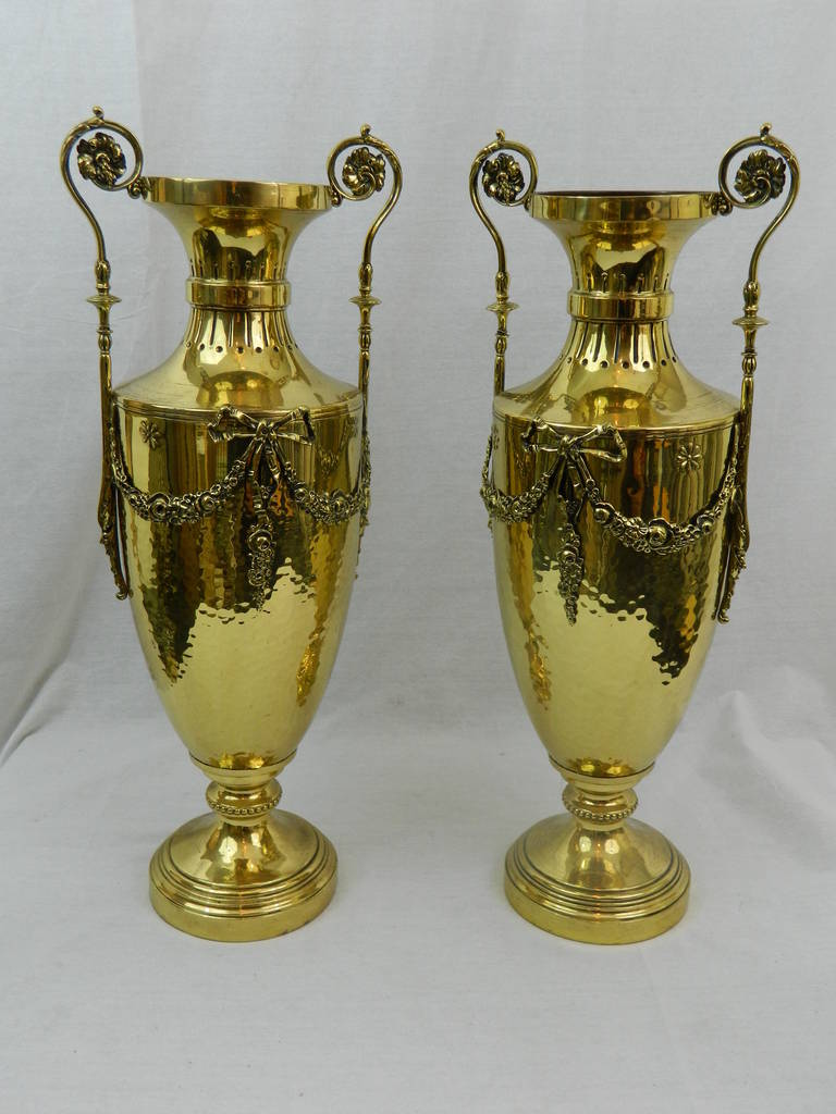 19th century pair of polished brass decorative urns or vases with handles.