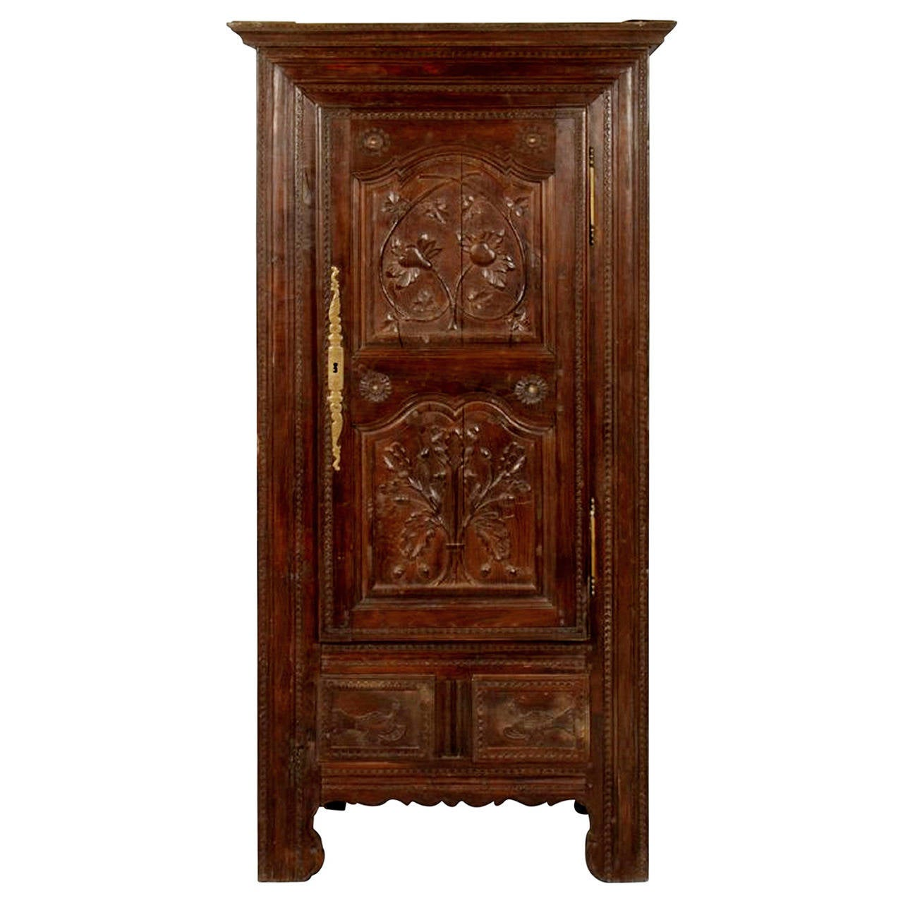A French Oak Bonnetiere with Carved Door, Early 19th Century