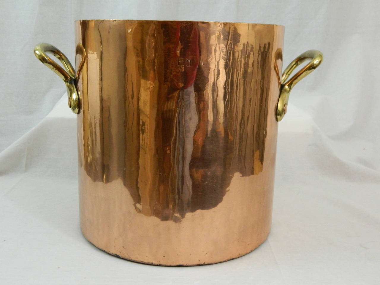 19th Century large copper stock pot with brass handles.  Professionally cleaned and polished.  32 quart
