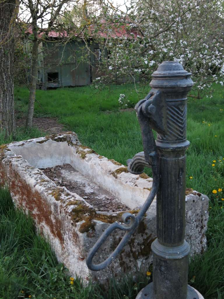 Hand-Crafted French Fountain in Limestone and Iron Water-Pump, 18th - 19th Century France For Sale