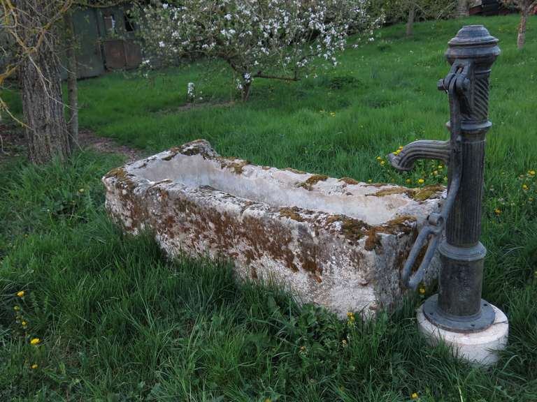A French Antique Countryside Water-Pump-Fountain in Limestone and Iron.  The basin in limestone is handcrafted from 18th century. The water pump in iron is handmade from the 19th century.  Extra-dimensions: Water-Pump: High 49.3 inches x Width