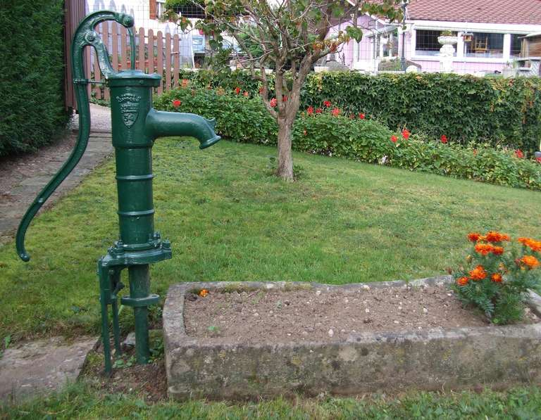 A French Fountain Water-Pump in Iron and Basion in Limestone Handmade circa 1870s from France. Handmade at French Foundry Alfred Corneau (Stamped Alfred Corneau).  Extra-dimensions: Basin in limestone: High 7.9 inches x Width 46.1 inches x Depth