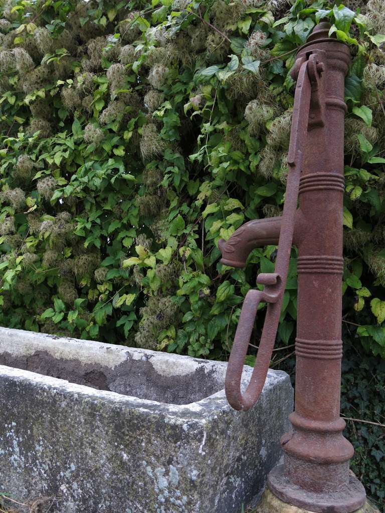 18th Century and Earlier Village Water Pump in antique limestone from France 18/19th Century For Sale