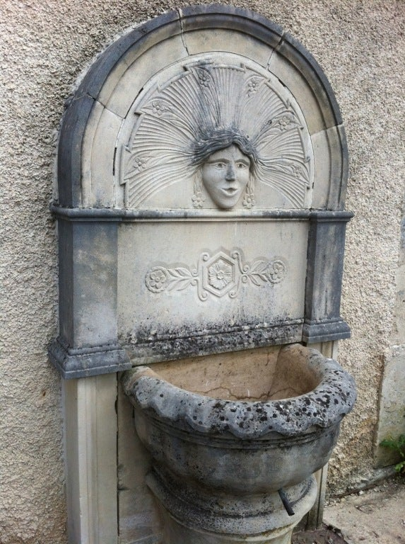 French Wall fountain in limestone dite