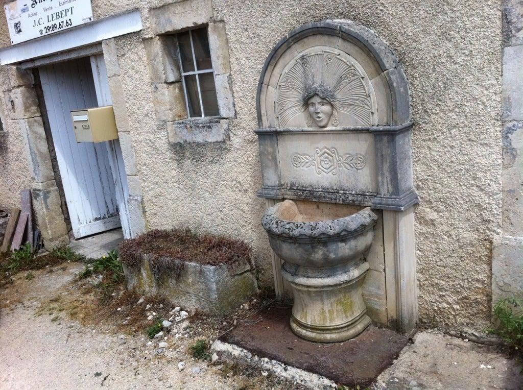 20th Century Wall fountain in limestone dite