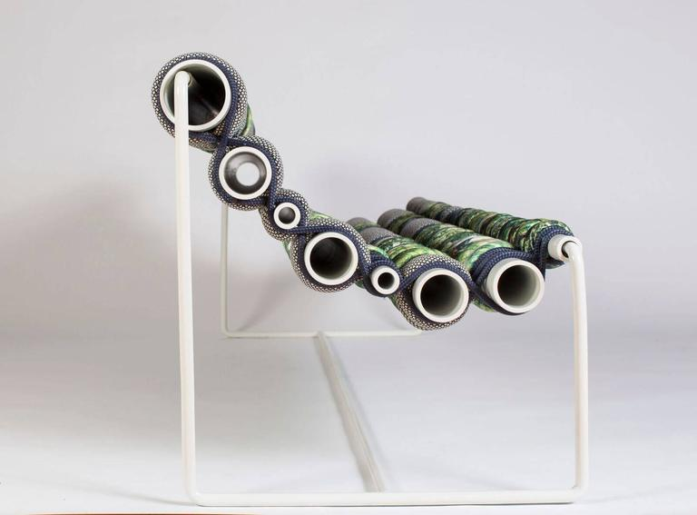 This Betil Dagdelen alloy bench is made with powder-coated aluminum pipes, steel, marine rope and upholstery fabric in 2016.   Betil Dagdelen was born in Izmir, Turkey in 1978. She studied political science and international relations at Koç