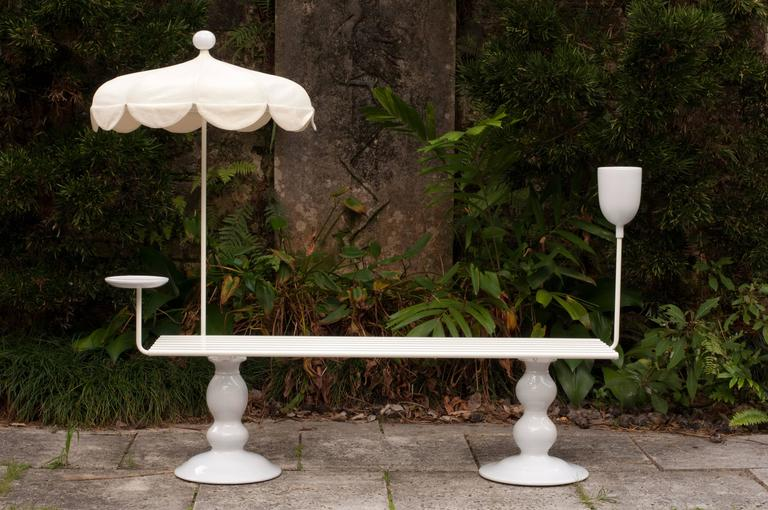 This playful, whimsical outdoor bench was created in 2012 by French designer Sam Baron for the Fairchild Tropical Botanic Garden's inaugural exhibition of Design at Fairchild: Sitting Naturally.   Made of white lacquered wood strips, metal and