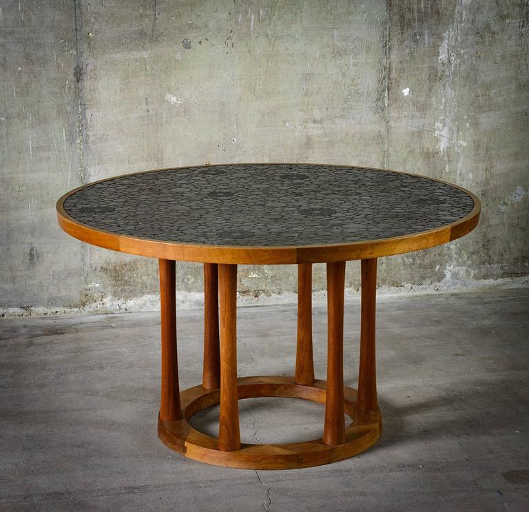 From Gordon and Jane Marshall Martz, for Marshall Studios, this dining table is made with round black glazed tiles and walnut. The piece is made in the USA at Veedersburg, Indiana, circa 1960s.  Good condition with minor scratches on base.