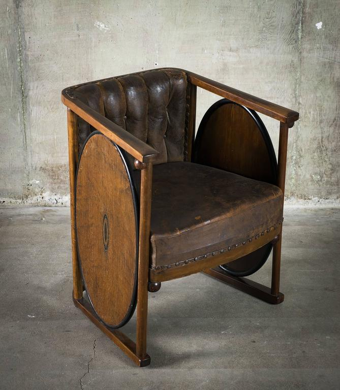 This rare and unusual armchair inlaid made of beechwood, marquetry and leather is attributed to Koloman Moser or Josef Hoffman. Model No. 422, Austria, circa 1907.  Condition distressed, vintage, wear to leather.