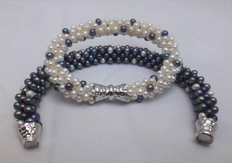 White pearl and black pearl are woven together to create a rope style necklace. Beads measure 3.5mm each, and woven into a thick tubular rope of approximately 1/3 of an inch. This unique, modern and one of a kind necklace can be worn day or night.