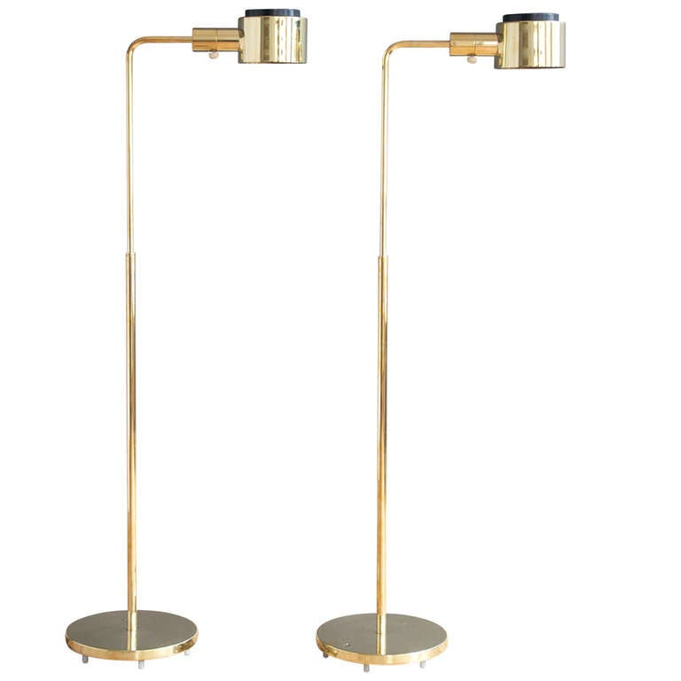 Pair of adjustable polished brass floor lamps by casella for Casella brass floor lamp