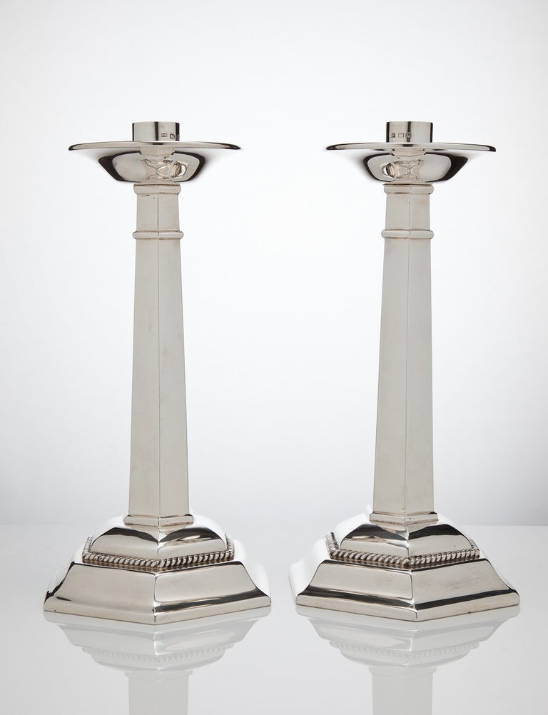 A stunning and large pair of English silver candlesticks of exceptional quality, created in Gothic design, all fully hallmarked and dated London, 1937 by makers Arthur Robert, Mayland.