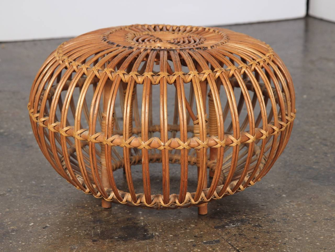 Franco Albini demonstrates the artful weaving of rattan. In great condition, rattan has some age-appropriate wear. Does not detract from the integrity of its sturdiness or its beautiful appearance. Perfect as a foot stool or a light-duty side table.