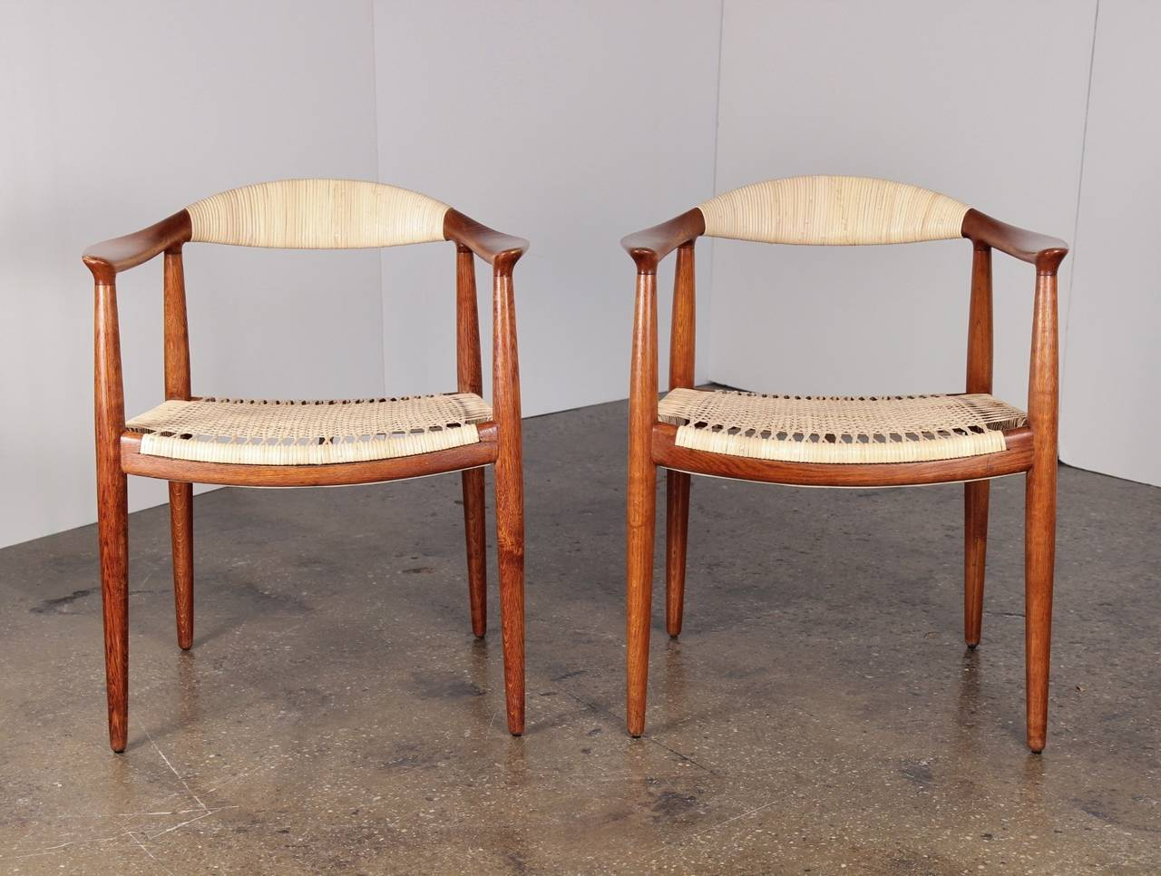 Lovely pair of oak and cane round chairs by Hans J. Wegner. Model JH & Cane Round Chairs by Hans Wegner at 1stdibs