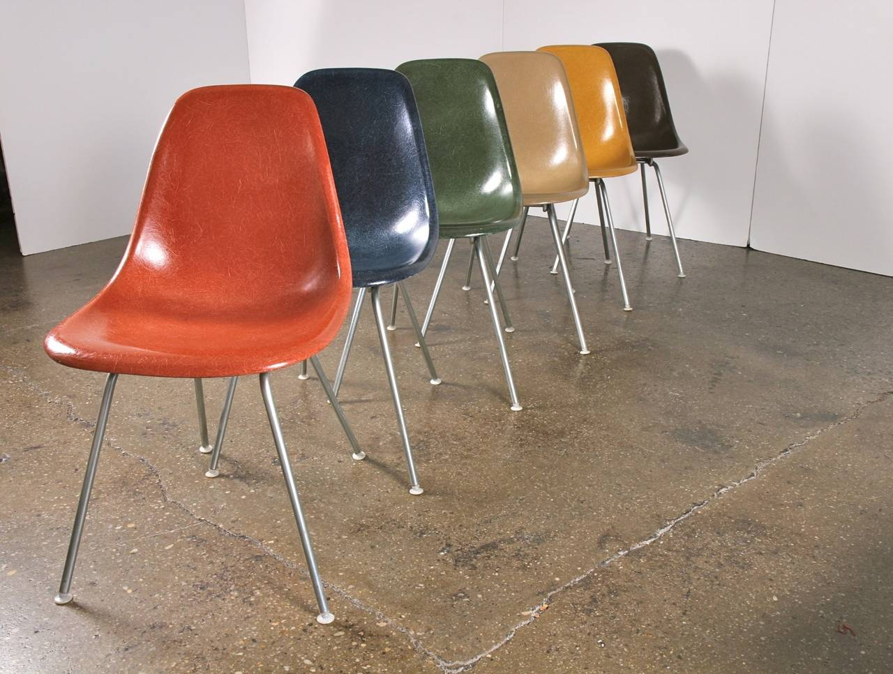 Vintage 1960s molded fiberglass side shell chairs designed by Charles and Ray Eames for Herman Miller. Gleaming shells are in original condition, each with a distinct thready texture. We have many colorways in stock, including Ochre Light Yellow,