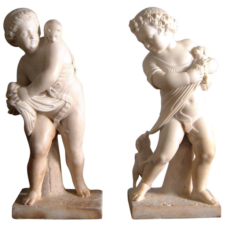 A pair of italian white marble sculptures