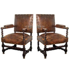 A Louis XIII style pair of armchairs, 19th c.