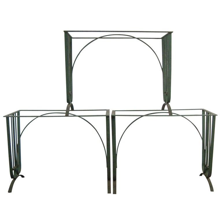 A set of five iron garden tables
