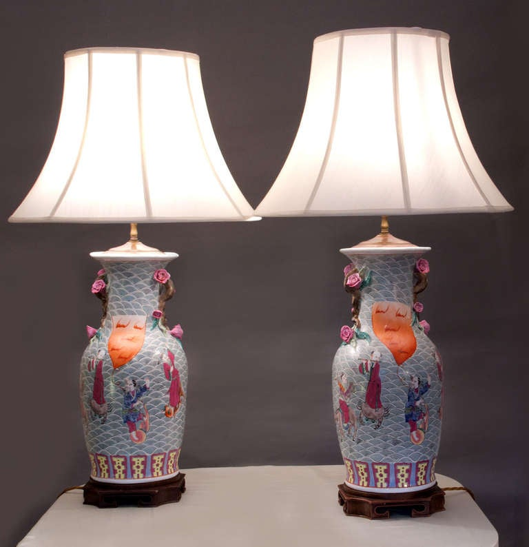 Pair of baluster form lamps, hand decorated with court scenes in polychrome on wood bases.