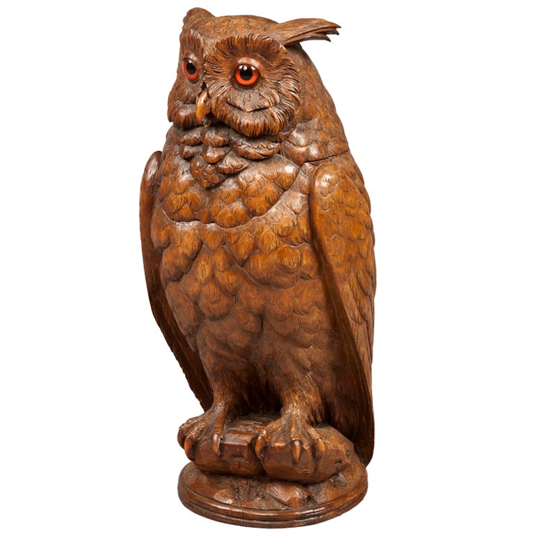 A carved black forest antique owl of exceptional size at