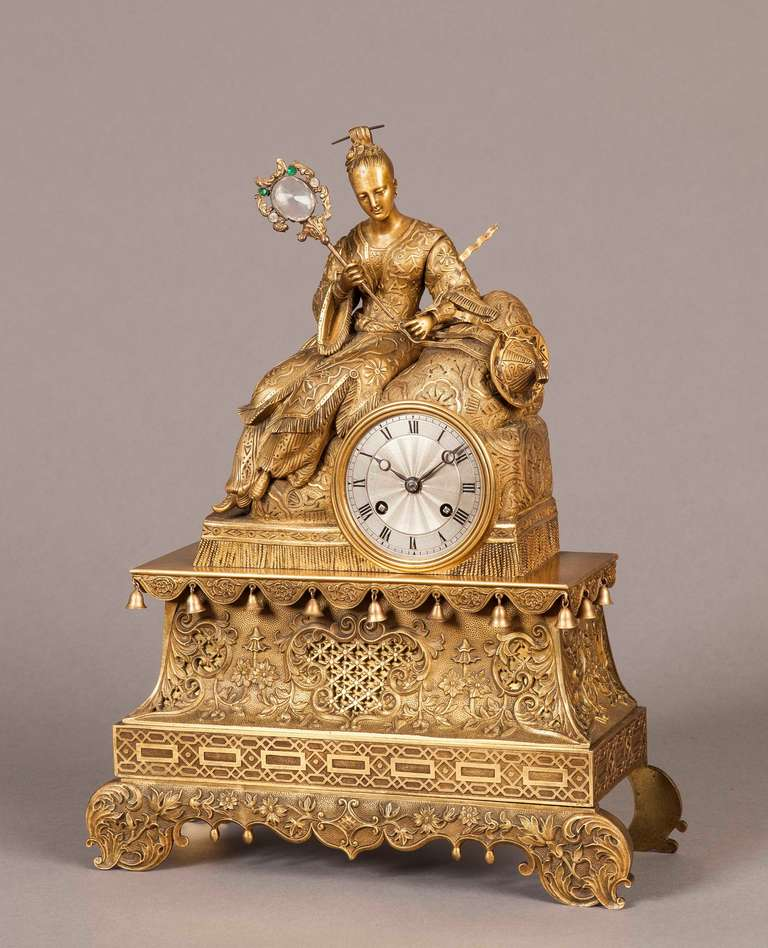 A good French antique mantel clock in the chinoiserie taste.