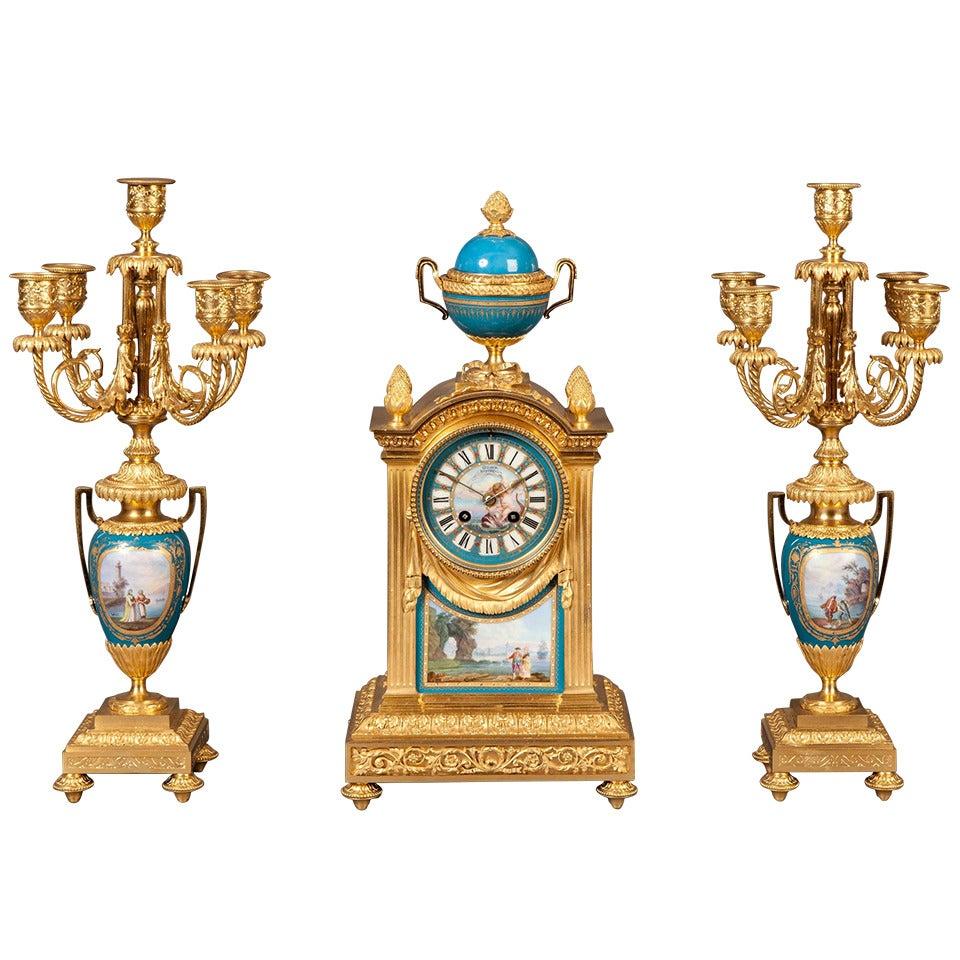 French Mantel Clock and Candelabra of Gilt Bronze and Blue 'Sèvres' Porcelain