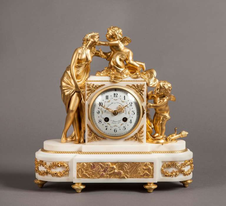An attractive Parisian mantle clock in the Louis XVI manner