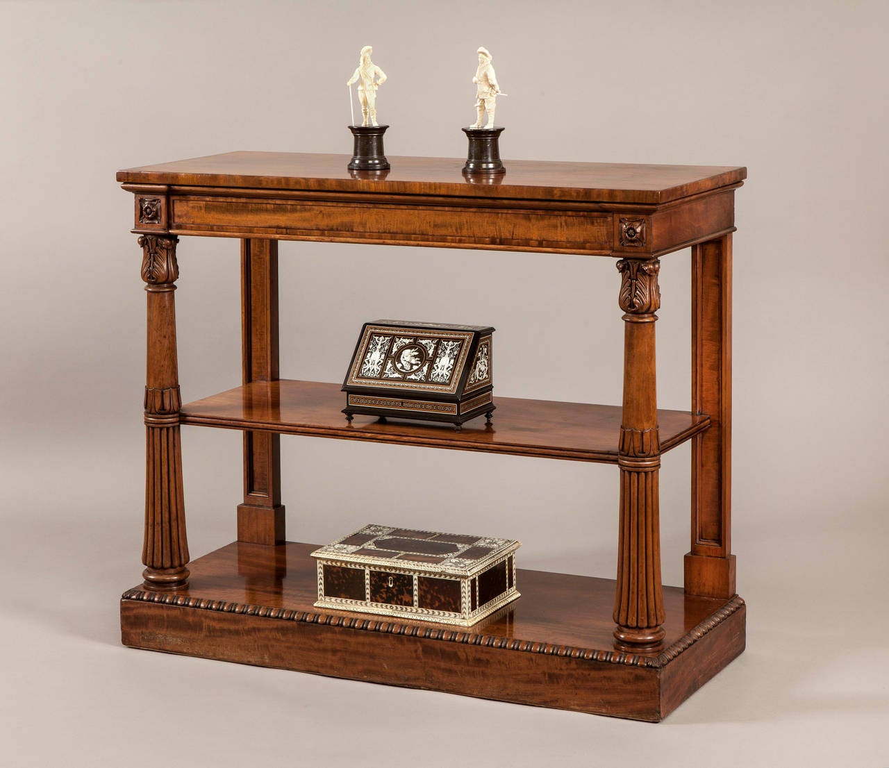 A serving table in the Regency period Neo-Grecian manner.